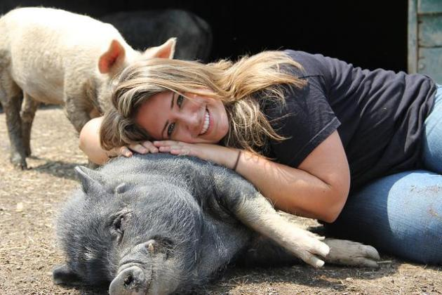 woman with pig, farm sanctuary, farm animal rescue