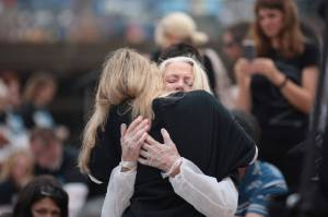 Sharing a much-needed hug with friend Patty Shenker.
