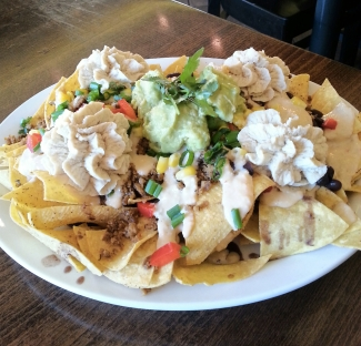 Vegan nachos with guacamole, sour cream, black beans, taco meat, and cheese (from Native Foods)