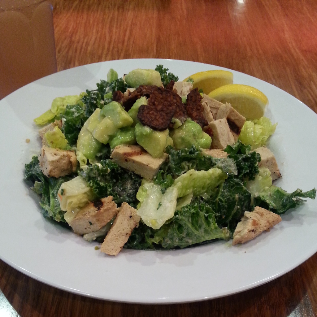 Vegan kale caesar salad with grilled chicken and bacon bits (from Veggie Grill)